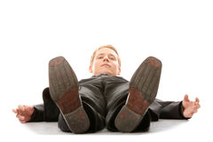 Businessman laying down in a suit Stock Image
