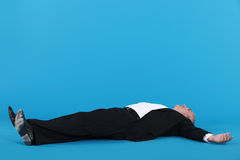 Businessman laying on floor Royalty Free Stock Photography