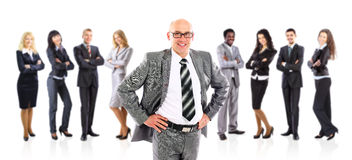 Businessman leader standing in front of his team Royalty Free Stock Photos