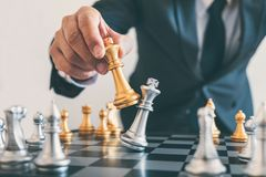 Businessman leadership playing chess and thinking strategy plan stock photos