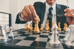 Businessman leadership playing chess and thinking strategy plan about crash overthrow the opposite team and development analyze. For successful of corporate stock images