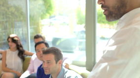 Businessman Leading Brainstorming Session With Colleagues stock video