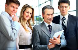 Businessman leading his team at office Royalty Free Stock Photos