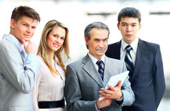 Businessman leading his team at office Stock Image