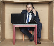 Businessman leading telephone conversation and working on a comp Royalty Free Stock Photo