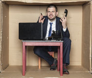 Businessman leading two calls at the same time, box office. Business man leading two calls at the same time, box office Stock Photography