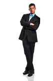 Businessman leaning. Young businessman leaning against a white wall stock photo
