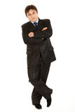 Businessman leaning against something Royalty Free Stock Image