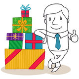 Businessman leaning against stack of gift boxes Royalty Free Stock Photography