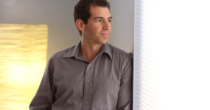 Businessman leaning against wall Royalty Free Stock Photography