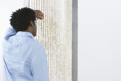 Businessman Leaning Against Wall Royalty Free Stock Photo