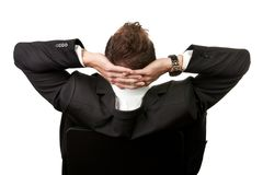 Businessman leaning back in the chair Royalty Free Stock Image