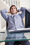 Businessman leaning back in his office Royalty Free Stock Photography