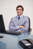 Businessman leaning back satisfied Royalty Free Stock Photos