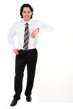 Businessman leaning on a billboard. Young businessman leaning on a billboard royalty free stock image