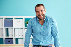 Businessman leaning on desk Stock Photography