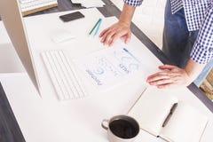 Businessman leaning on desktop Stock Image