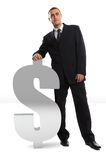 Businessman Leaning on dollar sign Stock Photos