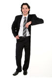 Businessman Leaning On A Billboard Stock Photo