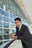 Businessman Leaning On Railing Royalty Free Stock Images
