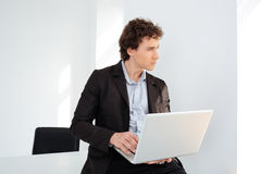 Businessman leaning on the table with laptop computer Royalty Free Stock Photography
