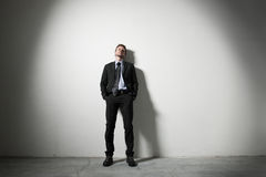 Businessman leaning on a wall Stock Photos