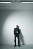 Businessman leaning on a wall Royalty Free Stock Photo