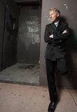 Businessman leaning on a wall at night Royalty Free Stock Image