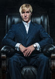 Businessman in leather chair Royalty Free Stock Photos