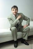 Businessman on leather sofa Stock Image