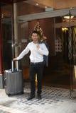 Businessman leaving hotel Royalty Free Stock Photos