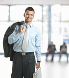 Businessman leaving office Stock Photo