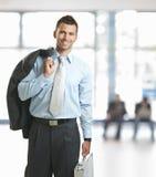 Businessman leaving office Stock Photo