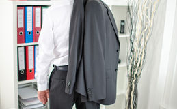 Businessman leaving the office Stock Images