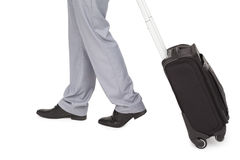 Businessman legs walking with a suitcase Stock Photos