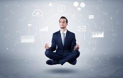 Businessman levitates with data circulation concept. Elegant calm businessman levitates in yoga position with data circulation concept Stock Photography