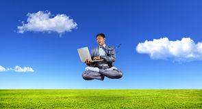 Businessman levitating with laptop Royalty Free Stock Image