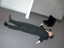 Businessman lies down Royalty Free Stock Photo
