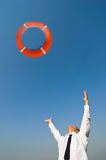 Businessman and life preserver stock photography