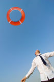Businessman and life preserver stock images