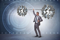 The businessman lifting barbell with dollars Royalty Free Stock Photo