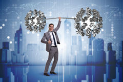 The businessman lifting barbell with dollars Royalty Free Stock Photos