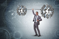 The businessman lifting barbell with dollars Stock Photos