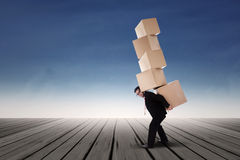 Businessman lifting boxes Stock Photo