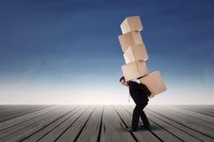 Businessman lifting boxes stock photo