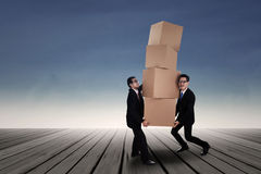 Businessman lifting boxes outdoor Royalty Free Stock Images