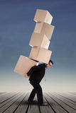 Businessman lifting boxes vertical Stock Image