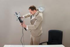 Businessman lifting desktop computer Royalty Free Stock Photo