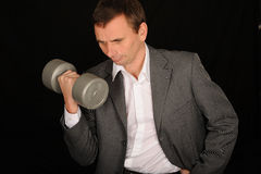 Businessman lifting dumbbell Stock Photo
