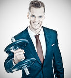 Businessman lifting a dumbbell Stock Photos